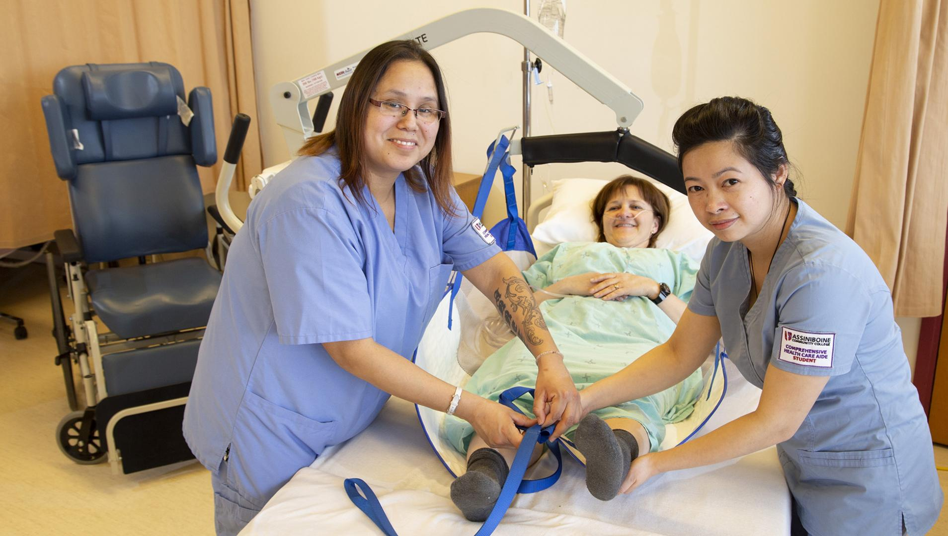 Comprehensive Health Care Aide students working with a patient
