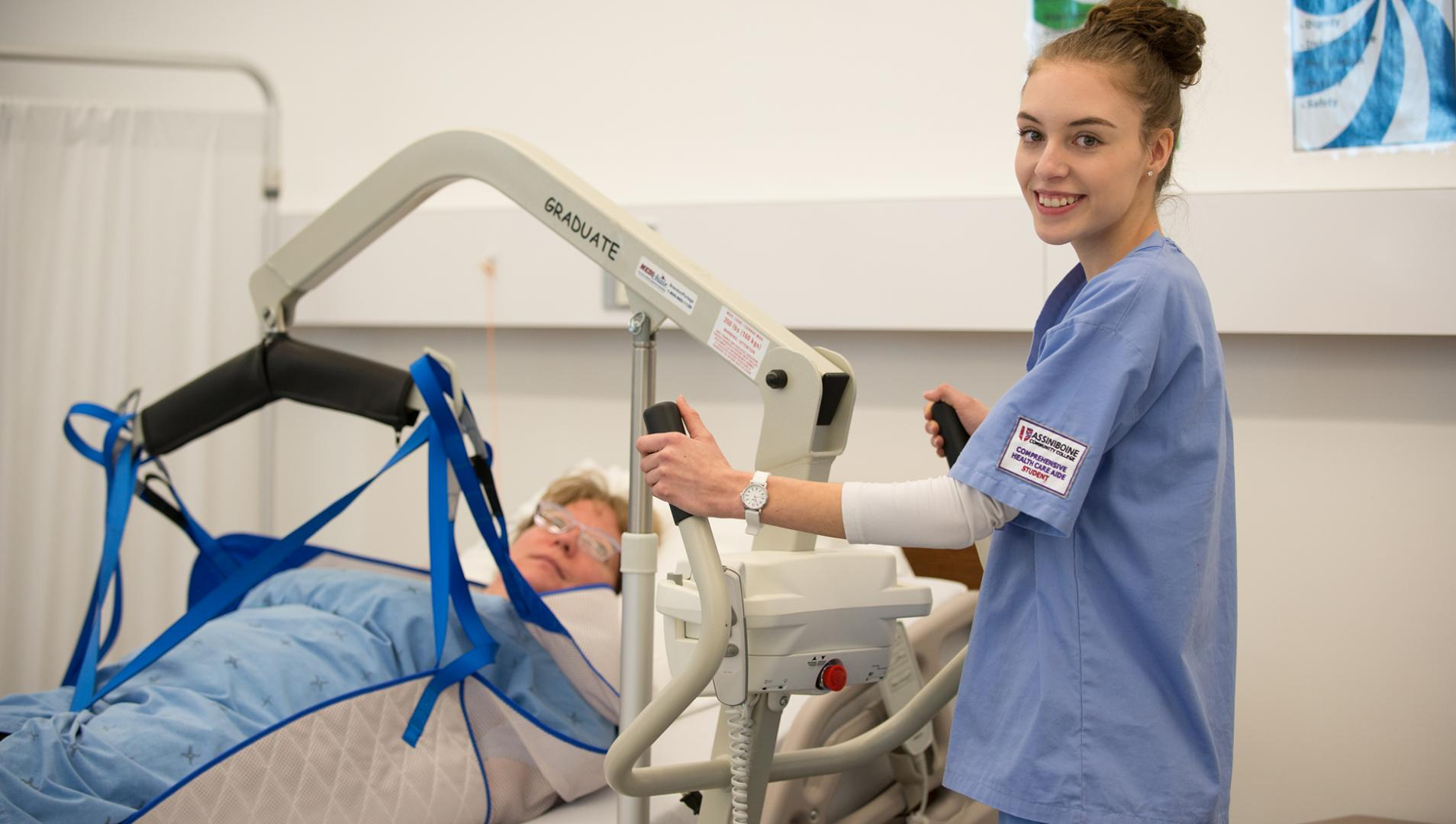 Comprehensive Health Care Aide student working with a patient