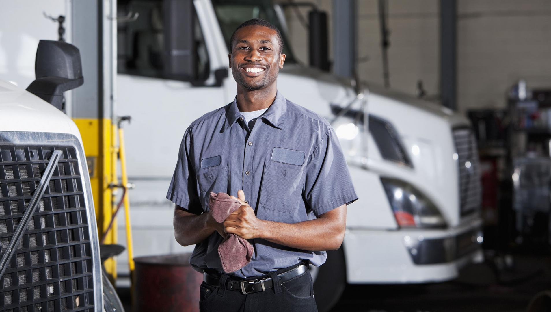 mechanic working on semi trucks