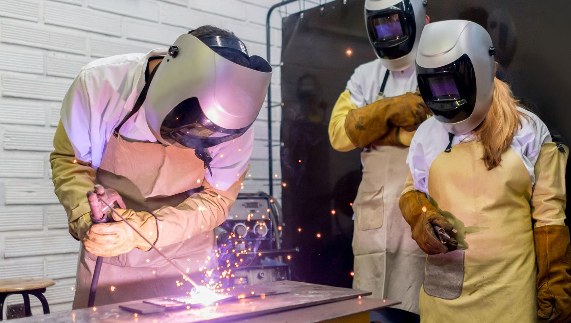 welding students in a classroom