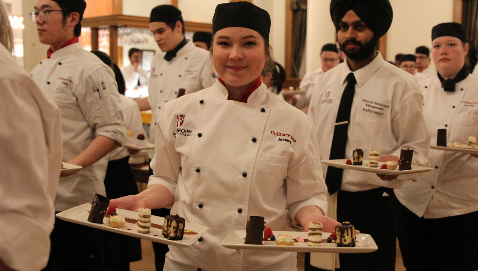 A culinary student prepares to serve dessert at the 2019 Foundation Gala Dinner